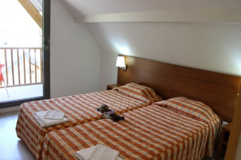 14-HPRT20---Residence-Mer-et-Golf-Tourmalet---Tourmalet-chambre.jpg