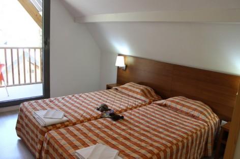 6-HPRT20---Residence-Mer-et-Golf-Tourmalet---Tourmalet-chambre.jpg